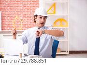 Купить «Construction supervisor working on blueprints», фото № 29788851, снято 13 сентября 2018 г. (c) Elnur / Фотобанк Лори