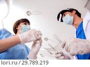 Купить «Concept of treating teeth at dentists», фото № 29789219, снято 23 июля 2018 г. (c) Elnur / Фотобанк Лори