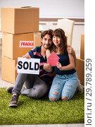 Купить «Young family selling their house», фото № 29789259, снято 21 сентября 2018 г. (c) Elnur / Фотобанк Лори
