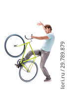 Купить «Young man with cycle isolated on white», фото № 29789879, снято 30 августа 2018 г. (c) Elnur / Фотобанк Лори