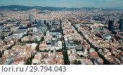 Купить «Modern cityscape of Barcelona on background with water surface of Mediterranean», видеоролик № 29794043, снято 24 июля 2018 г. (c) Яков Филимонов / Фотобанк Лори