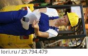 Купить «Portrait of young woman worker during inventory construction materials in build store», видеоролик № 29794479, снято 16 октября 2018 г. (c) Яков Филимонов / Фотобанк Лори