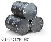 Black metal oil barrels isolated on white background. Oil and petroleum industry. Стоковое фото, фотограф Maksym Yemelyanov / Фотобанк Лори