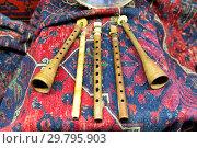 Традиционный музыкальный армянский инструмент дудук на ковре. Стоковое фото, фотограф Евгений Ткачёв / Фотобанк Лори