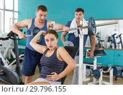 Купить «Girl injured during exercising with barbell», фото № 29796155, снято 5 ноября 2018 г. (c) Яков Филимонов / Фотобанк Лори