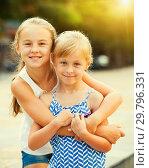 Купить «Two smiling little girls embracing», фото № 29796331, снято 20 июля 2017 г. (c) Яков Филимонов / Фотобанк Лори