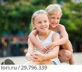 Купить «Two small happy sisters outdoors», фото № 29796339, снято 20 июля 2017 г. (c) Яков Филимонов / Фотобанк Лори