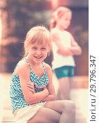Купить «Two quarreled little girls», фото № 29796347, снято 20 июля 2017 г. (c) Яков Филимонов / Фотобанк Лори