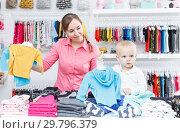 Купить «Portrait happy boy with mother in kid store», фото № 29796379, снято 18 апреля 2018 г. (c) Яков Филимонов / Фотобанк Лори