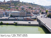 Купить «Embankment of the Mtkvari river and historic Sololaki district in Tbilisi. Summer day», фото № 29797055, снято 7 августа 2013 г. (c) Олег Хархан / Фотобанк Лори