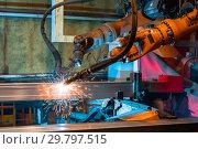 Купить «Welding robot, the process of welding a metal profile.», фото № 29797515, снято 27 сентября 2018 г. (c) Андрей Радченко / Фотобанк Лори