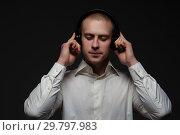 Купить «Young male music lover listens to music», фото № 29797983, снято 8 декабря 2018 г. (c) Pavel Biryukov / Фотобанк Лори