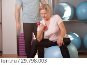 Middle aged woman is engaged on fitball. Стоковое фото, фотограф Pavel Biryukov / Фотобанк Лори