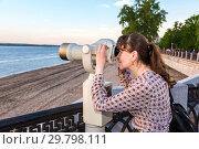 Купить «Young woman looking through the coin operated binocular», фото № 29798111, снято 19 мая 2018 г. (c) FotograFF / Фотобанк Лори