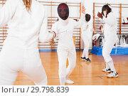 Купить «Two female fencers exercising movements in duel at fencing room», фото № 29798839, снято 11 июля 2018 г. (c) Яков Филимонов / Фотобанк Лори