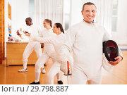Купить «Man fencer in uniform with mask and foil», фото № 29798887, снято 11 июля 2018 г. (c) Яков Филимонов / Фотобанк Лори