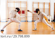 Купить «fencers at fencing workout, practicing attack movements», фото № 29798899, снято 11 июля 2018 г. (c) Яков Филимонов / Фотобанк Лори
