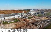 Купить «Wood processing at a woodworking plant.Aerial view.», видеоролик № 29799359, снято 16 июля 2019 г. (c) Никита Ковалёв / Фотобанк Лори