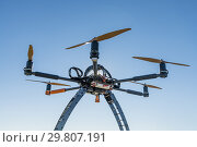 Professional drone before a flight in a sunny day. Стоковое фото, фотограф Carlos Dominique / age Fotostock / Фотобанк Лори