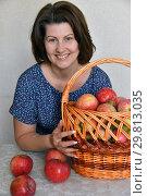 Купить «woman with a basket of red apples sits at table», фото № 29813035, снято 25 августа 2018 г. (c) Володина Ольга / Фотобанк Лори