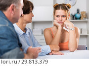 Купить «Parents are comforting the upset adult daughter at the table», фото № 29813379, снято 25 октября 2017 г. (c) Яков Филимонов / Фотобанк Лори