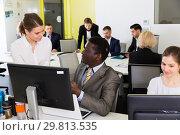 Купить «Business people working in coworking space», фото № 29813535, снято 10 марта 2018 г. (c) Яков Филимонов / Фотобанк Лори