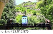 Купить «Old soviet rusty and functioning ropeway or cable car cabins in Chiatura», видеоролик № 29813875, снято 27 января 2019 г. (c) Mikhail Starodubov / Фотобанк Лори
