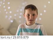 Купить «Innocent boy sitting in bedroom at home», фото № 29819879, снято 6 ноября 2018 г. (c) Wavebreak Media / Фотобанк Лори