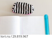 Купить «Notebook, ruler and pencil case on the desk in school», фото № 29819967, снято 10 ноября 2018 г. (c) Wavebreak Media / Фотобанк Лори