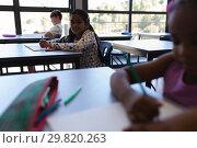 Купить «School kids sitting and working in classroom», фото № 29820263, снято 10 ноября 2018 г. (c) Wavebreak Media / Фотобанк Лори