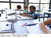 Купить «Schoolboy sitting at desk and looking at camera in classroom», фото № 29820299, снято 10 ноября 2018 г. (c) Wavebreak Media / Фотобанк Лори