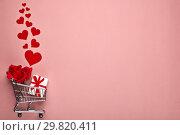 Купить «Shopping trolley with gifts. Valentine's day,», фото № 29820411, снято 27 января 2019 г. (c) Мельников Дмитрий / Фотобанк Лори