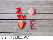 Купить «close up of word love made of sweets», фото № 29820507, снято 8 февраля 2018 г. (c) Syda Productions / Фотобанк Лори