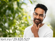 Купить «smiling indian man touching his beard», фото № 29820527, снято 27 октября 2018 г. (c) Syda Productions / Фотобанк Лори