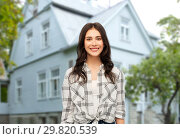 Купить «teenage girl in checkered shirt over house», фото № 29820539, снято 10 ноября 2018 г. (c) Syda Productions / Фотобанк Лори