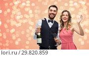 Купить «happy couple with bottle of champagne and glasses», фото № 29820859, снято 30 ноября 2018 г. (c) Syda Productions / Фотобанк Лори