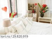 Купить «cozy bedroom decorated for valentines day», фото № 29820919, снято 15 февраля 2018 г. (c) Syda Productions / Фотобанк Лори