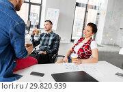 Купить «creative team drinking coffee at office», фото № 29820939, снято 1 апреля 2018 г. (c) Syda Productions / Фотобанк Лори