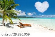 Купить «beach with two sunbeds and heart shaped cloud», фото № 29820959, снято 16 февраля 2018 г. (c) Syda Productions / Фотобанк Лори