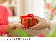 Купить «close up of male and female hands with gift box», фото № 29820991, снято 15 февраля 2018 г. (c) Syda Productions / Фотобанк Лори