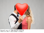 Купить «couple hiding behind red heart shaped balloon», фото № 29821027, снято 30 ноября 2018 г. (c) Syda Productions / Фотобанк Лори