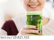 Купить «close up of woman with green beer in glass», фото № 29821103, снято 31 января 2018 г. (c) Syda Productions / Фотобанк Лори
