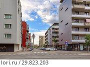 Купить «Современные жилые здания района Фаворитен. Вид на радиовышку. Вена, Австрия.», фото № 29823203, снято 12 июля 2017 г. (c) Bala-Kate / Фотобанк Лори