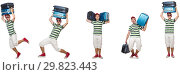 Купить «Young man with heavy suitcases isolated on white», фото № 29823443, снято 19 февраля 2019 г. (c) Elnur / Фотобанк Лори