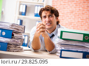 Купить «Young elegant man unhappy with too much work», фото № 29825095, снято 14 сентября 2018 г. (c) Elnur / Фотобанк Лори