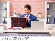 Купить «Young handsome employee working in the office», фото № 29825191, снято 12 сентября 2018 г. (c) Elnur / Фотобанк Лори