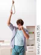 Купить «Young man preparing to commit suicide by hanging», фото № 29825751, снято 25 сентября 2018 г. (c) Elnur / Фотобанк Лори