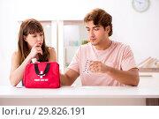 Купить «Young family getting treatment with first aid kit», фото № 29826191, снято 24 августа 2018 г. (c) Elnur / Фотобанк Лори
