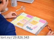Купить «Young handsome employee planning his work activity», фото № 29826343, снято 1 августа 2018 г. (c) Elnur / Фотобанк Лори
