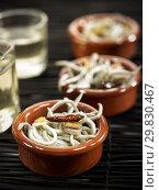 Cazuelita de angulas al ajillo / elvers fried with garlic. Стоковое фото, фотограф Becky Lawton Photography / age Fotostock / Фотобанк Лори